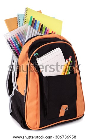 School bag with student supplies isolated on white background - stock photo