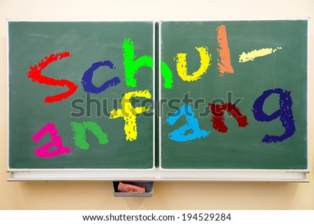 school blackboard with the german words starting school / Chalkboard - stock photo
