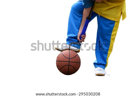 School boe hand pumping up basketball over white background
