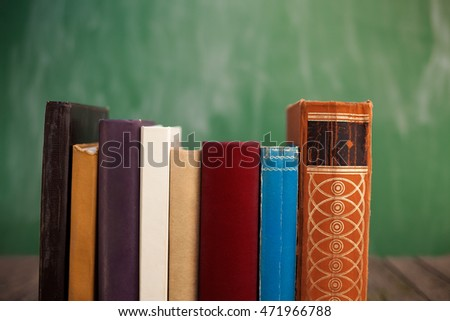 School books in line with green background