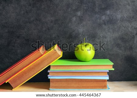 School books on a black background
