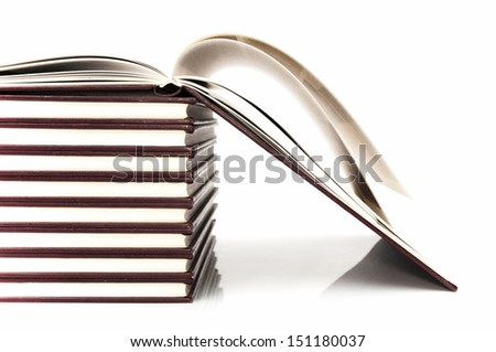 school books on a white background
