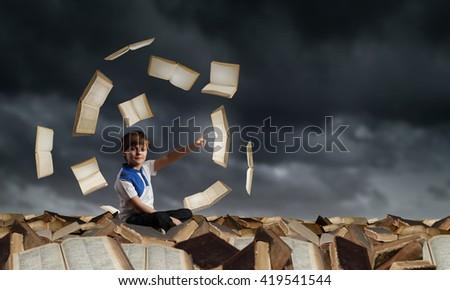 School boy among books - stock photo