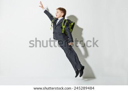 School boy flying - stock photo
