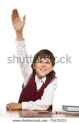 School boy hand raised for answer or question - stock photo