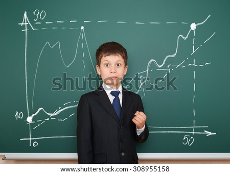 school boy in suit show graphs on board