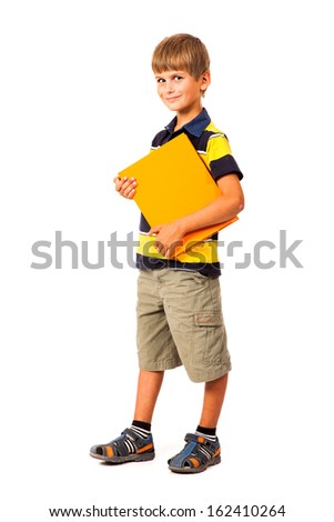 School boy is holding a book isolated on white background - stock photo