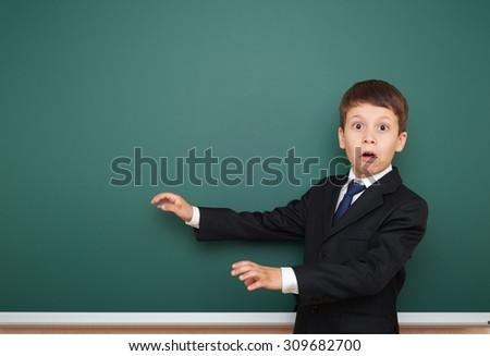 school boy portrait on board background - stock photo