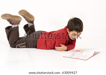 school boy reading a book - stock photo