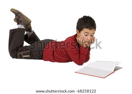 school boy reading a book - stock photo