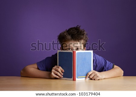School Boy Reading and Fooling Around - stock photo