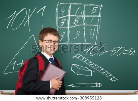 school boy with drawing on board - stock photo