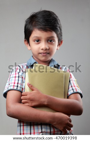 School boy with note books in his hands