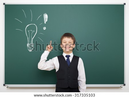 school boy with painted lightbulb having idea
