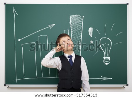 school boy with painted lightbulb on board