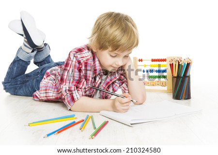 School boy writing exercise in notebook. Schoolboy do a sum of mathematics homework, isolated on white background