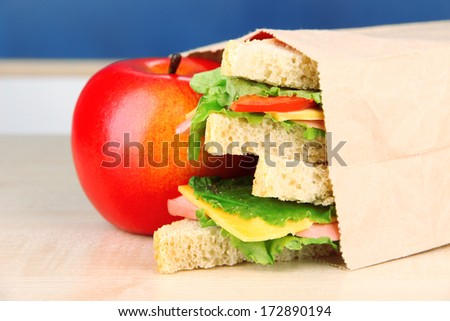 School breakfast on desk on  board background - stock photo