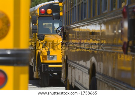 School bus detail with many reflections - stock photo