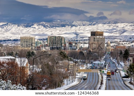 School Bus drives down Capital Boulevard Boise Idaho winter - stock photo