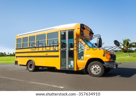 School buss standing on the parking - stock photo