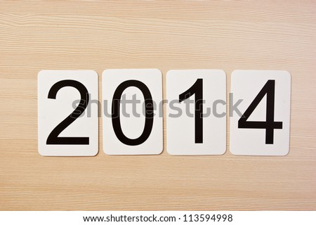School card with new year 2014  on the table - stock photo