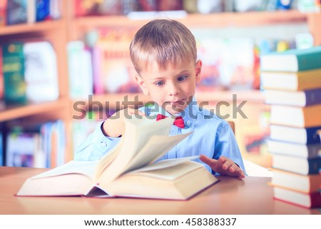 School Child Boy in Glasses Think in Classroom, Kid Primary Students Reading Book, Pupil Learn Lesson and Dream, Education