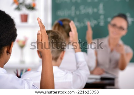 School child with teacher in classroom during lesson. concept of school - stock photo