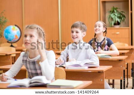 school children at lesson in classroom - stock photo