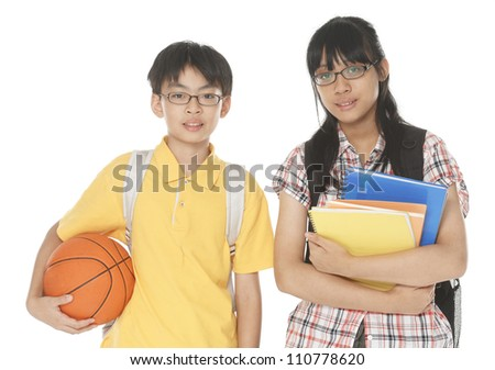 School children, boy and girl, with backpacks ,ball isolated - stock photo