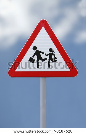 School children crossing sign with a soft  sky background - stock photo