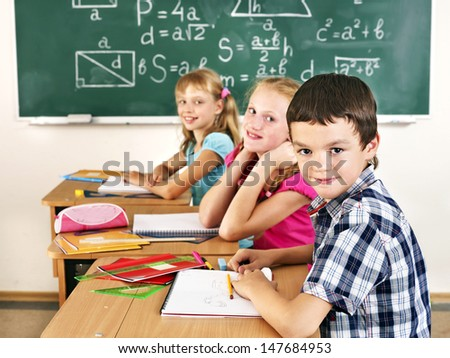 School children girl and boy in classroom.