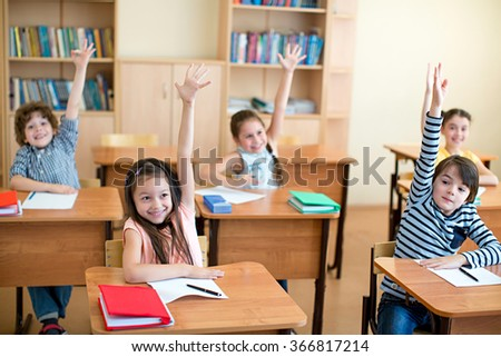 School children in a classroom - stock photo