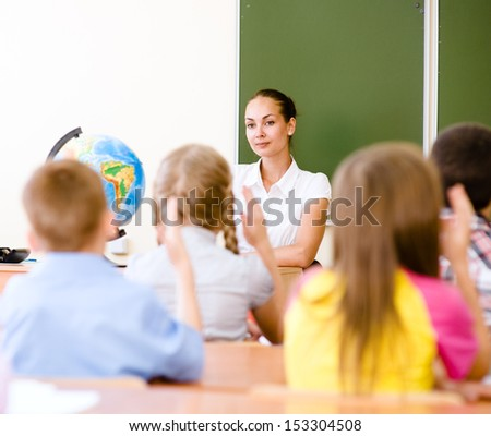 School children in classroom at lesson