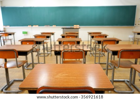 School classroom with school desks and blackboard in Japanese high school - stock photo