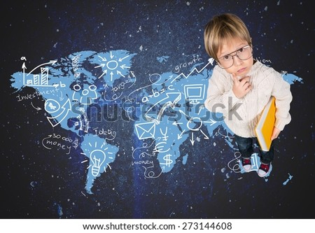 School. Clever little boy in glasses standing on abstract book planet - stock photo