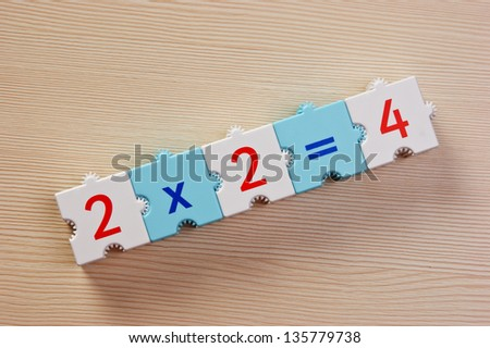School cubes with math problems on the table