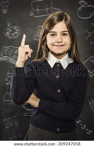 School doodles against cute pupil smiling at camera - stock photo