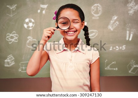 School doodles against portrait of cute little girl holding magnifying glass - stock photo