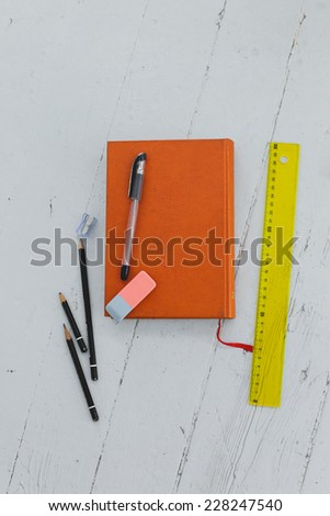 School, education. Book with pencils on the table - stock photo