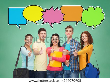 school, education, communication, gesture and people concept - group of smiling students with folders and school bags showing thumbs up over green board background with text bubbles - stock photo