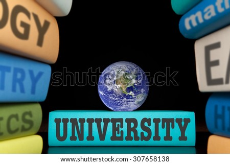 school education study books with text learning building knowledge, globe is courtesy of NASA, http://visibleearth.nasa.gov/. - stock photo