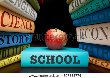 school education study books with text learning building knowledge with healthy apple - stock photo