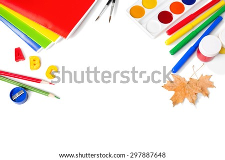 School equipment with pencils, paints , brushes and autumn leaves isolated on white. Back to school concept. School stationery - stock photo