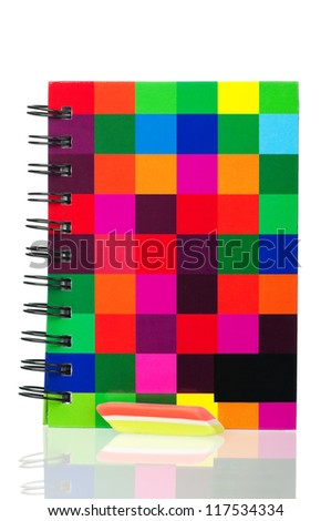 School exercise-book with tricolor eraser isolated on white background
