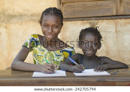 School For African Children - Couple Smiling Whilst Learning  - stock photo