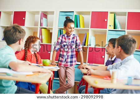 School friends guessing who they are during play - stock photo