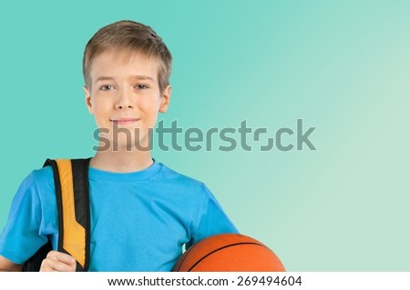 School. Full length portrait of a schoolboy with backpack holding a basketball, isolated on white background - stock photo