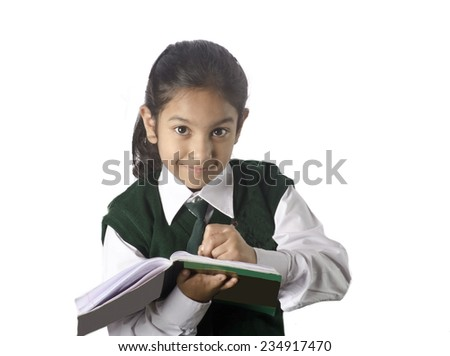 school girl doing her class work - stock photo