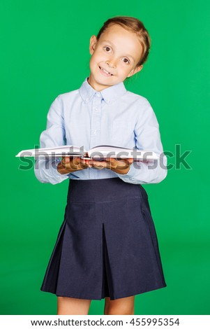 school girl in a school uniform holding a book. Learning and school concept. Image on chromakey background. - stock photo