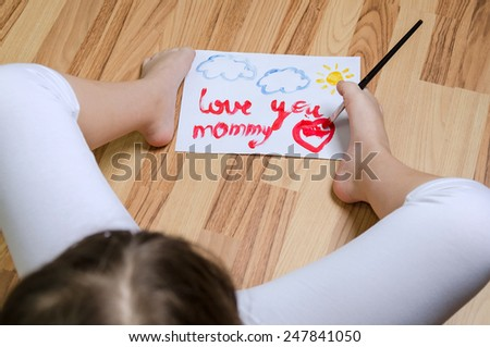 School girl painting with foot - stock photo